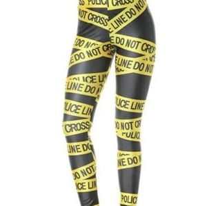 Womans black and yellow police tape legging